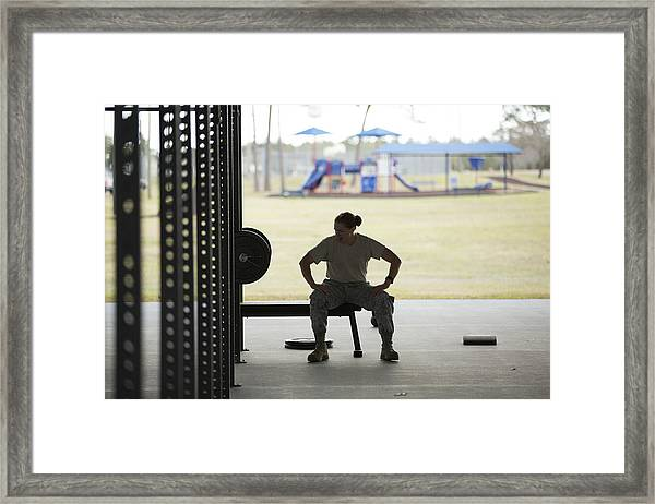 Silhouetted Female Soldier Barbell Training At Air Force Military Base Framed Print by Sean Murphy
