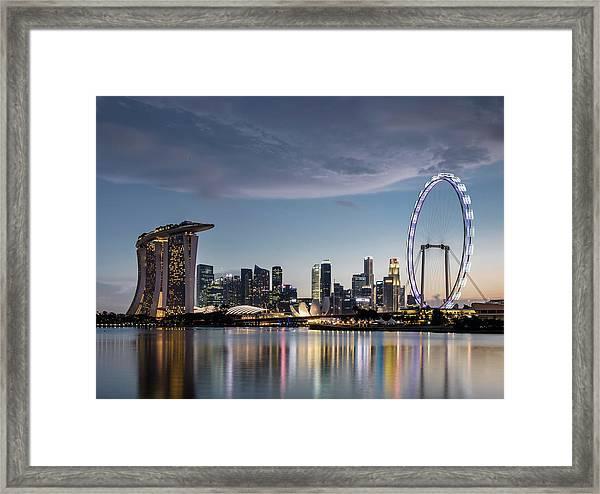Singapore Skyline At Dusk Framed Print by Martin Puddy