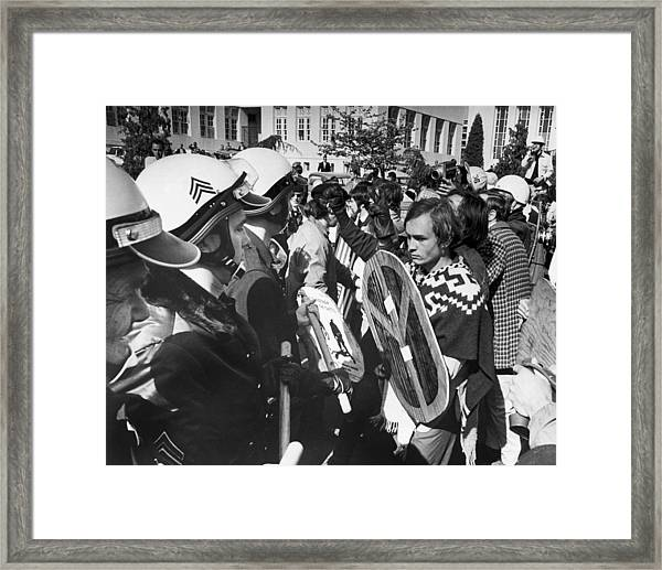 Sixties Protest Face Off Framed Print