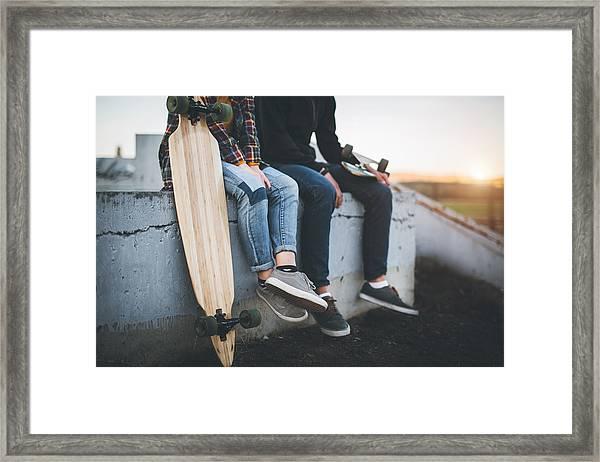 Skateboarders Taking A Rest In Skate Park Framed Print by Hobo_018