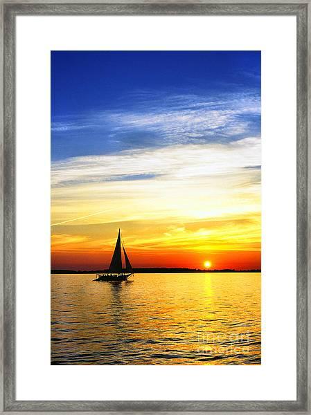 Skipjack Under Full Sail At Sunset Framed Print