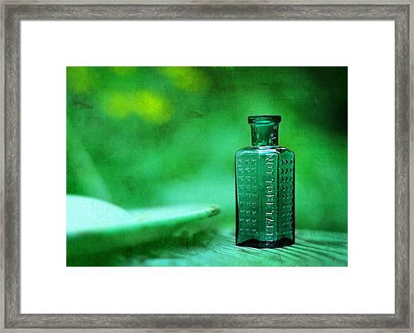 Small Green Poison Bottle Framed Print