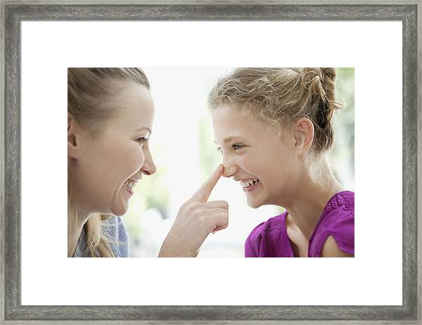 Smiling Mother Touching Daughters Nose Framed Print by Sam Edwards