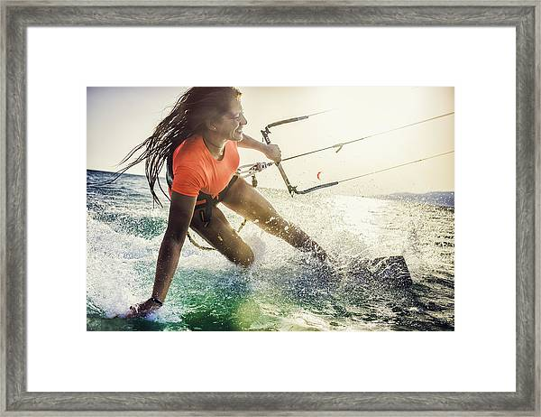 Smiling Young Female Kiteboarder On The Sea Framed Print by Vm