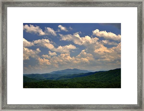 Smoky Peaks And Sky Framed Print