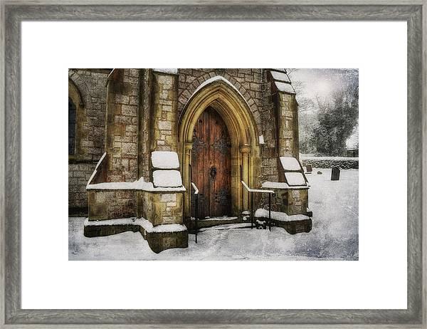 Snowy Church Door Framed Print