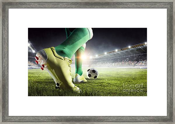 Soccer Player In Action. Mixed Media Framed Print