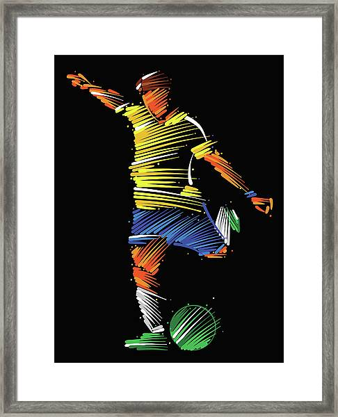 Soccer Player Running To Kick The Ball Framed Print