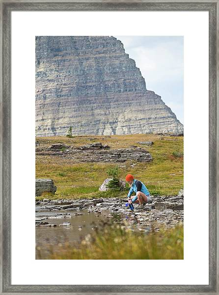 Solo Female Camper Filtering Water Framed Print