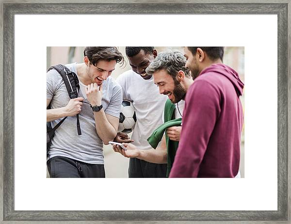 Sports Guys With Smart Phone Having Fun Framed Print by Hinterhaus Productions