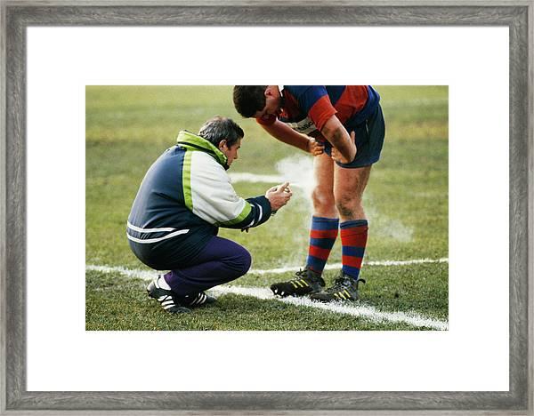 Sportsman Recieving Treatment Framed Print