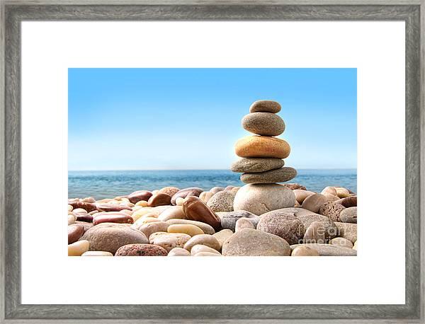Stack Of Pebble Stones On White Framed Print