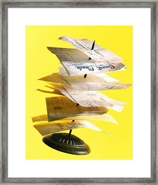 Stack Of Receipts On Restaurant Spike Framed Print by Brian Hagiwara