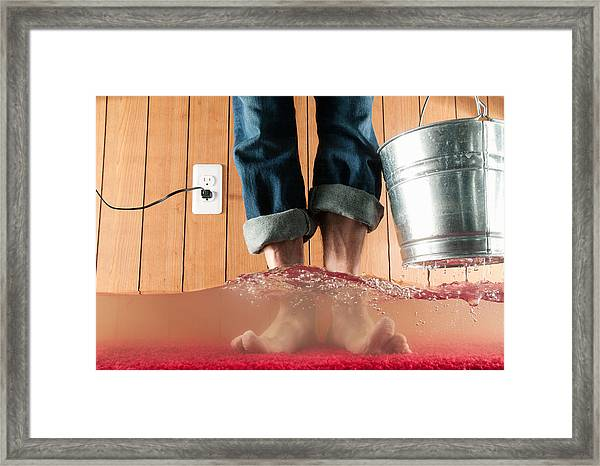 Standing In Flooded Basement Framed Print by PM Images