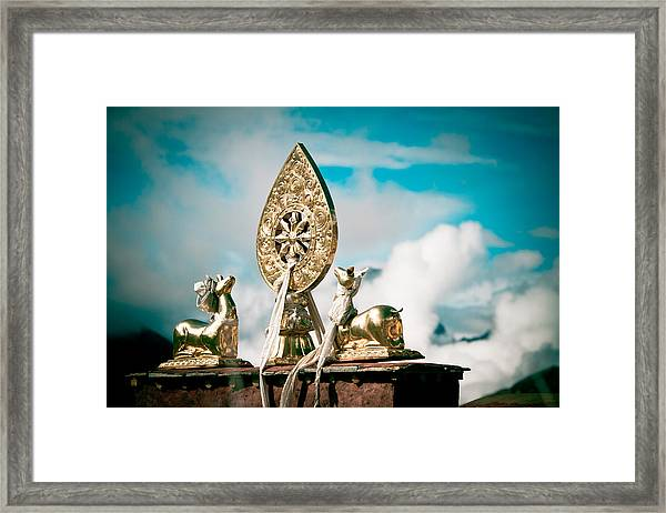 Framed Print featuring the photograph Stautes Of Deer And Golden Dharma Wheel by Raimond Klavins