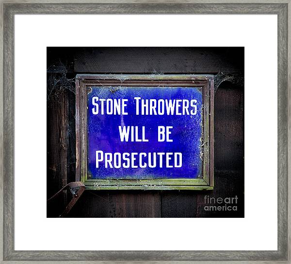 Stone Throwers Be Warned Framed Print