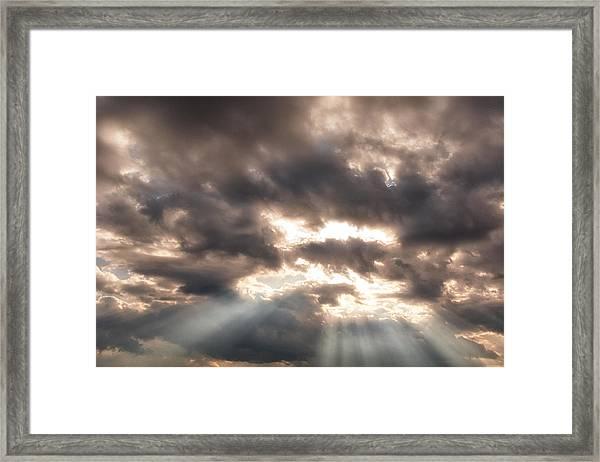 Storm Rays Framed Print