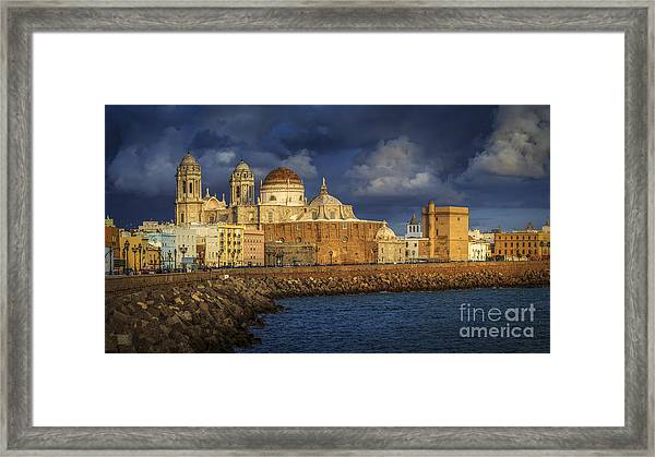 Stormy Skies Over The Cathedral Cadiz Spain Framed Print
