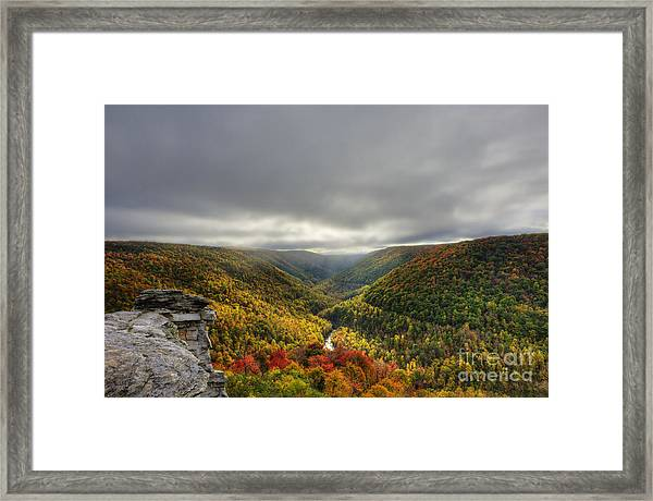 Sun Finding Openings In The Clouds Framed Print