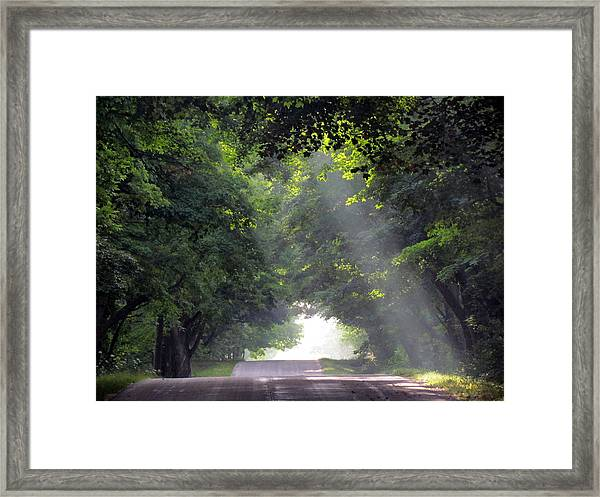 Sun Rays On Waters End Road Framed Print