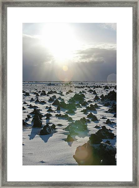 Sun Shining On A Field Of Lava Rocks Framed Print by Thomas Kokta