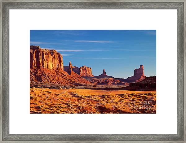 Framed Print featuring the photograph Sunrise Over Monument Valley by Brian Jannsen