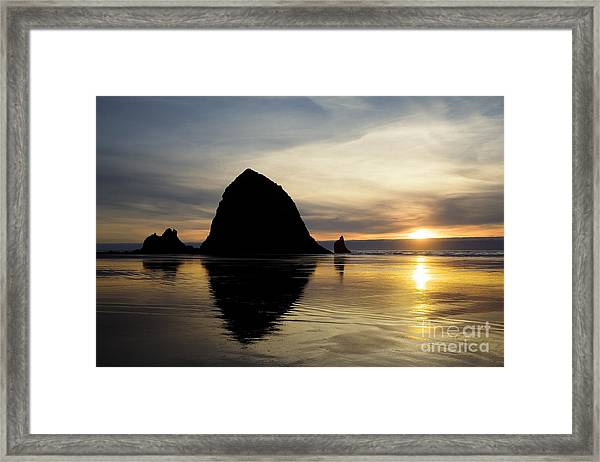 Sunset At Haystack Rock Framed Print
