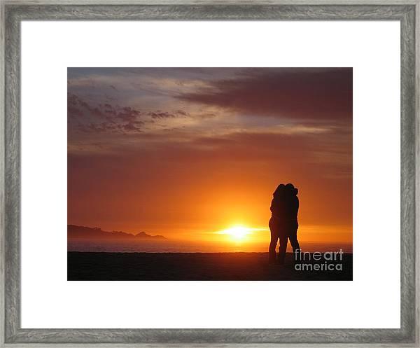 Sunset Cuddle Framed Print
