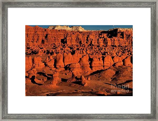 Sunset Light Turns The Hoodoos Blood Red In Goblin Valley State Park Utah Framed Print