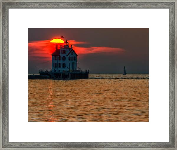 Sunset On Lighthouse Framed Print