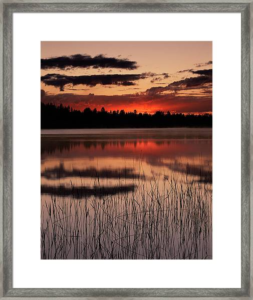 Sunset Over A Lake Framed Print