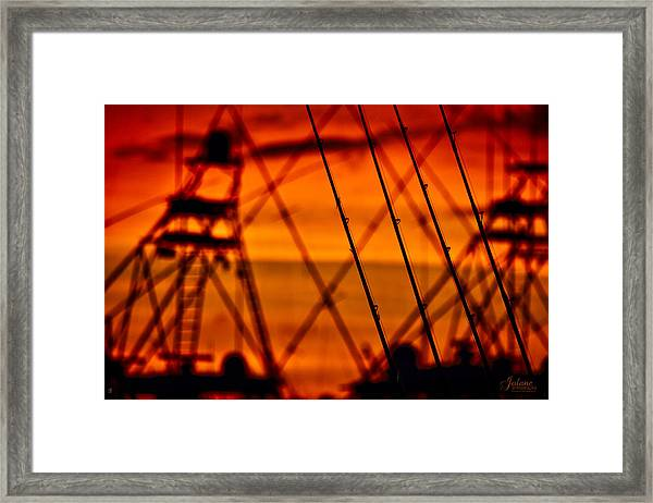 Sunset Over Sailfish Framed Print