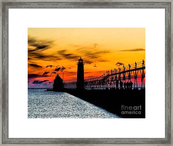 Sunset Walking On Grand Haven Pier Framed Print