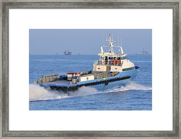 Supply Vessel Heads To Sea Framed Print