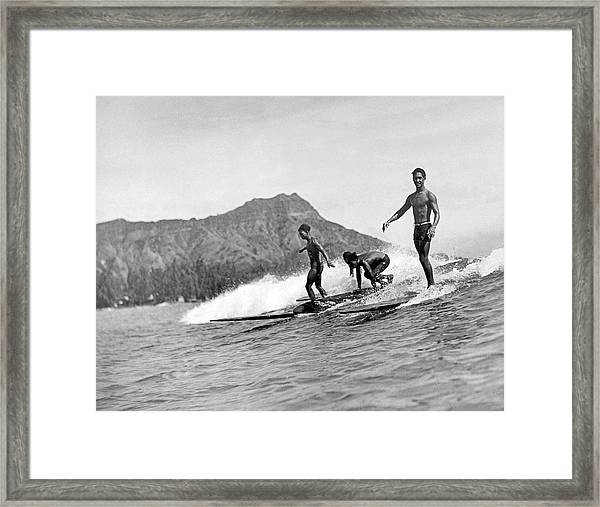 Surfing In Honolulu Framed Print
