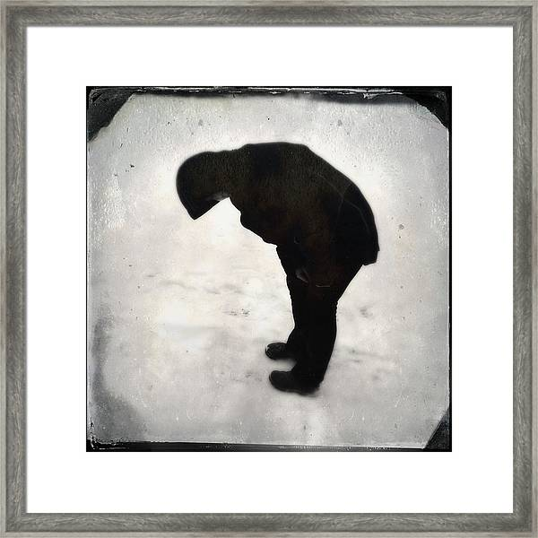 Surreal Silhouette Of A Person In The Snow Framed Print