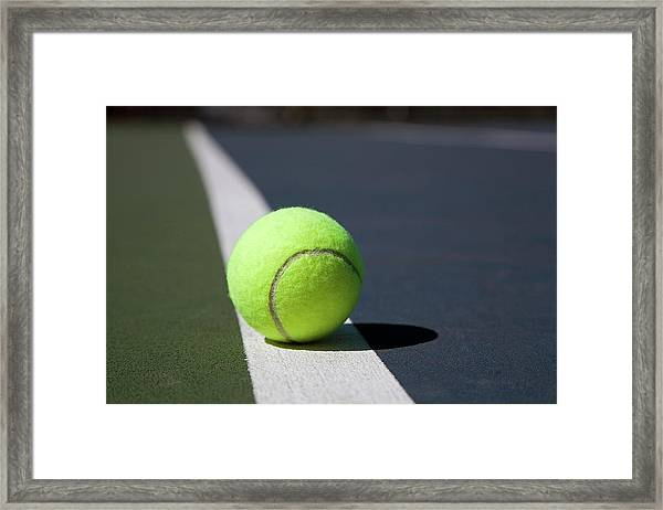 Tennis Ball On A Line In A Court Framed Print