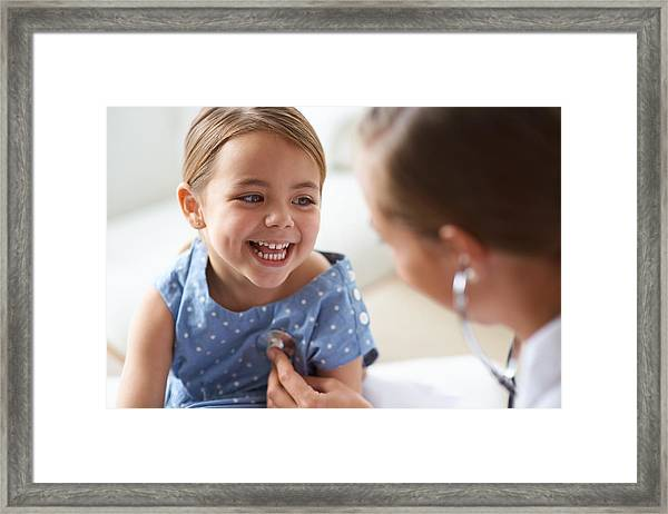 That Tickles! Framed Print by PeopleImages