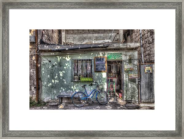 The Barber Shop Framed Print