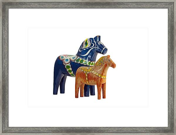 The Blue And Red Dala Horse Framed Print