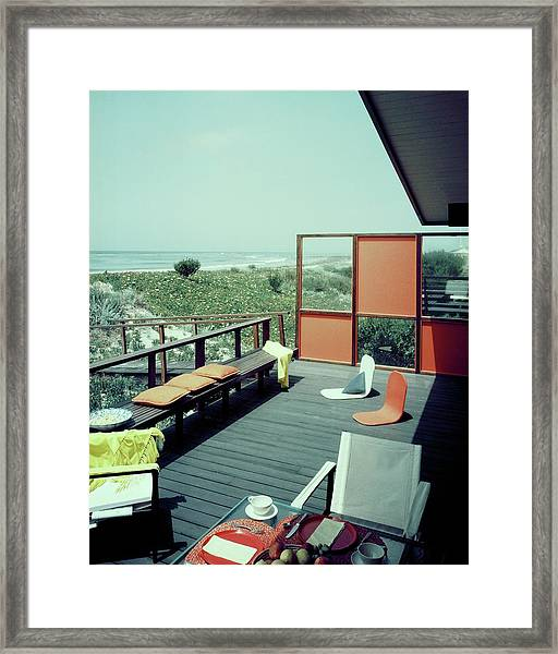 The Deck Of A Beach House Framed Print