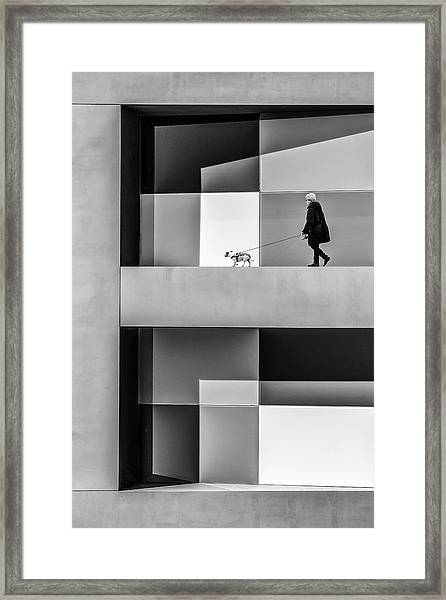 The E Walk Framed Print