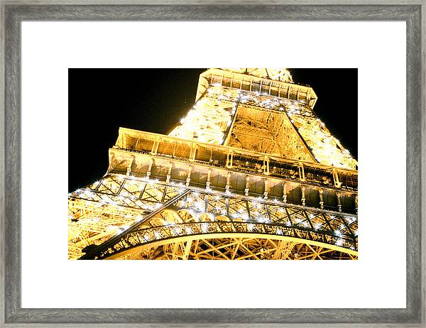 Framed Print featuring the photograph The Eiffel Tower At Night by Raimond Klavins