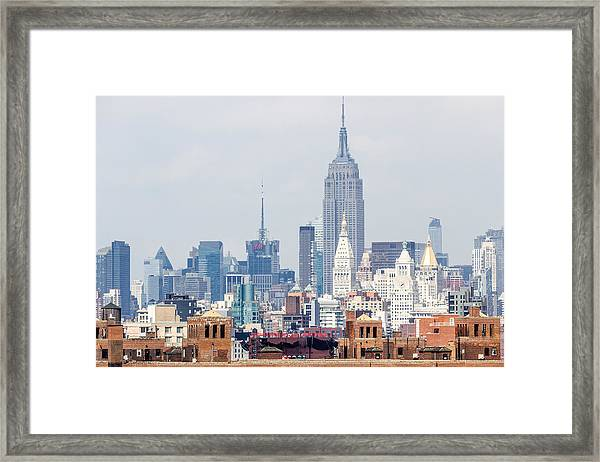 The Empire State Building From The Brooklyn Bridge Framed Print