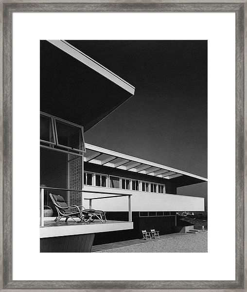 The Exterior Of A Beach House Framed Print by Robert M. Damora