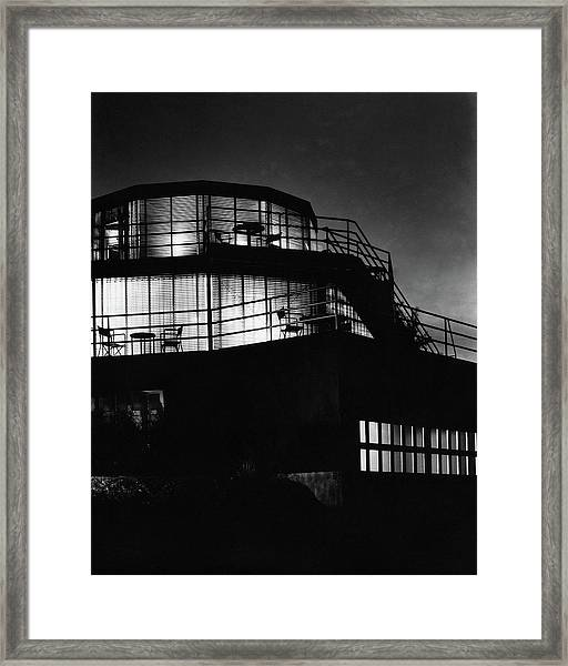 The Exterior Of A Spiral House Design At Night Framed Print