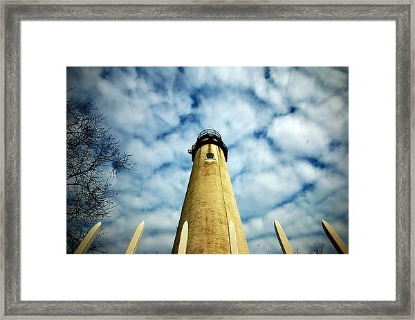 The Fenwick Light And A Mackerel Sky Framed Print