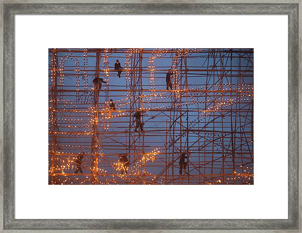 The Festival Runs Ship Fire Framed Print