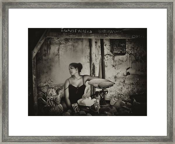 The Girl In The Market Framed Print