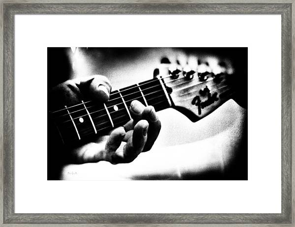 The Guitar Framed Print